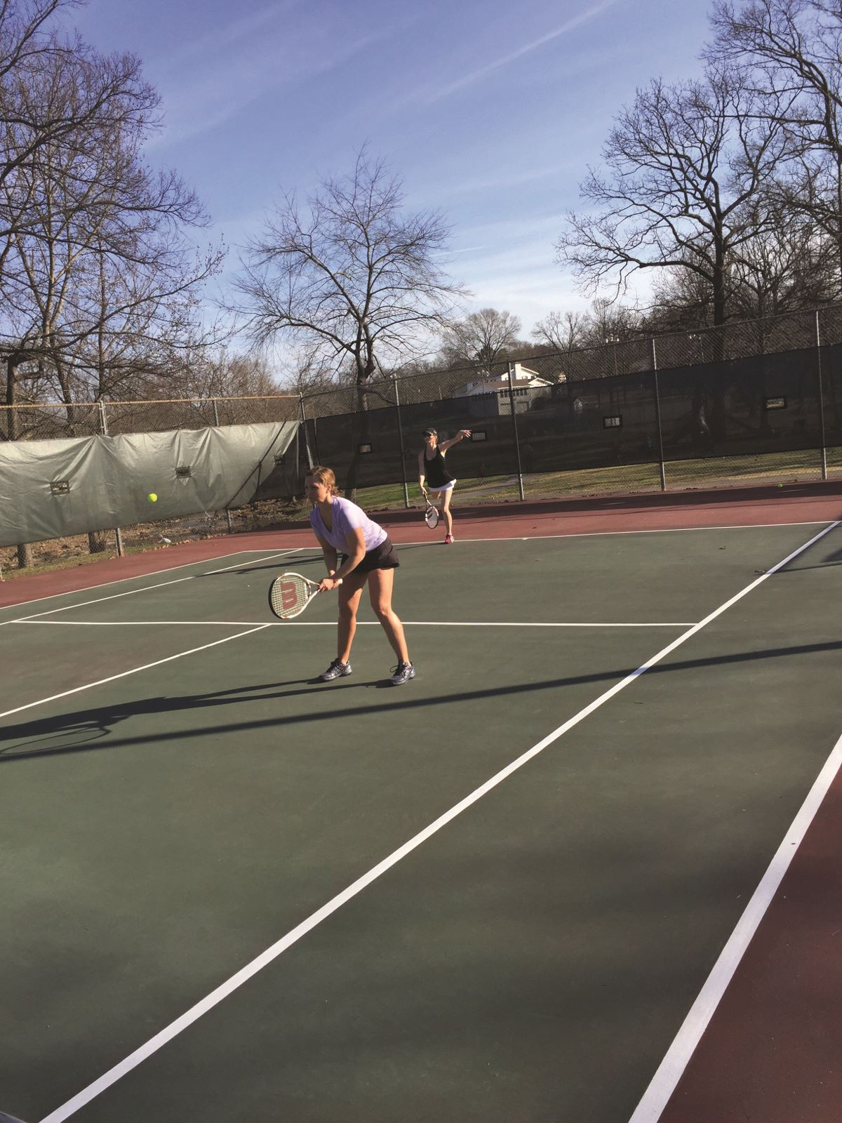 Two ladies playing tennis at Henson Park Tennis Center.